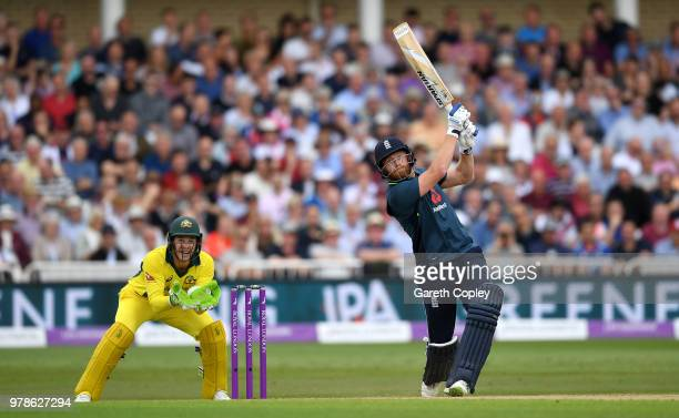 Jonathan Bairstow of England hits out of six runs watched Australia wicketkeeper Tim Paine during the 3rd Royal London ODI match between England and...