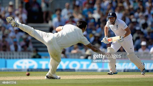 Jonathan Bairstow of England hits past Mitchell Johnson of Australia during day three of the 5th Investec Ashes Test match between England and...