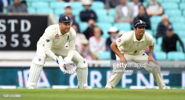 Jonathan Bairstow of England keeps wicket alongside Alastair Cook during day five of the Specsavers 5th Test match between England and India at The...