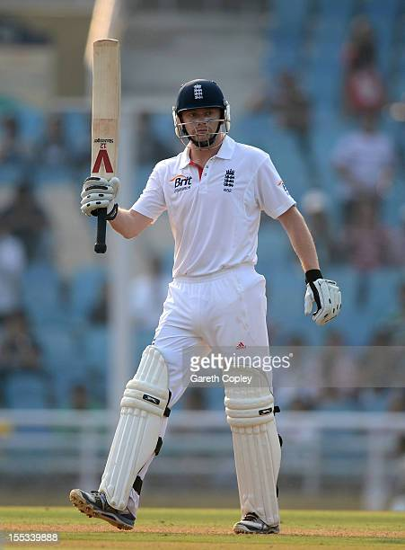 Jonathan Bairstow of England salutes the crowd after reaching his century during day one of the tour match between Mumbai A and England at The Dr...