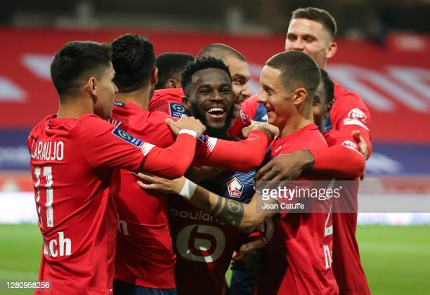 Jonathan Bamba of Lille celebrates his goal with teammates during the Ligue 1 match between Lille OSC and RC Lens at Stade Pierre Mauroy on October...