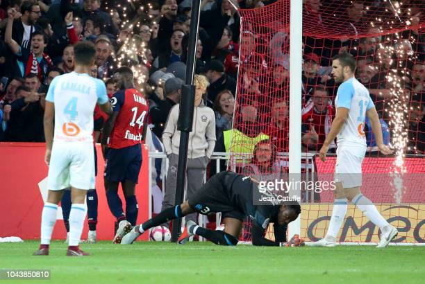 Jonathan Bamba of Lille celebrates his second goal while goalkeeper of Marseille Steve Mandanda lies down during the french Ligue 1 match between...