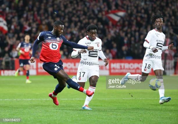 Jonathan Bamba of Lille Faitout Maouassa Eduardo Camavinga of Stade Rennais during the Ligue 1 match between Lille OSC and Stade Rennais at Stade...