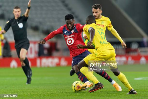Jonathan Bamba of Lille OSC compete for the ball with Pedro Chirivella and Denis Appiah of FC Nantes during the Ligue 1 match between Lille OSC and...
