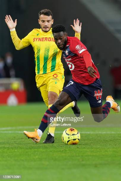 Jonathan Bamba of Lille OSC compete for the ball with Pedro Chirivella of FC Nantes during the Ligue 1 match between Lille OSC and FC Metz at Stade...