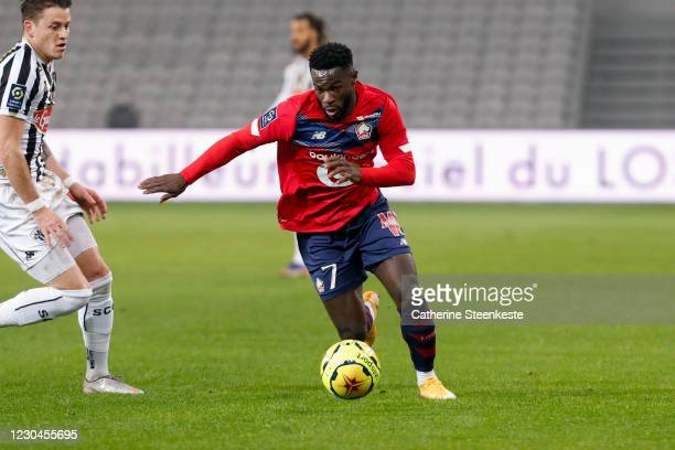 Jonathan Bamba of Lille OSC controls the ball against Pierrick Capelle of Angers SCO during the Ligue 1 match between Lille OSC and Angers SCO at...