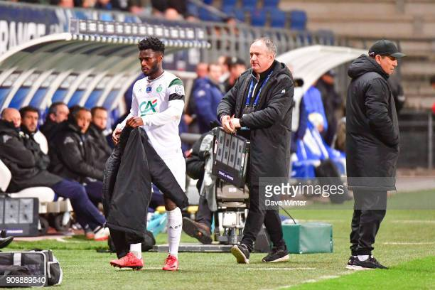 Jonathan Bamba of St Etienne is disappointed to be substituted by St Etienne coach Jean Louis Gasset during the French National Cup match round of 32...
