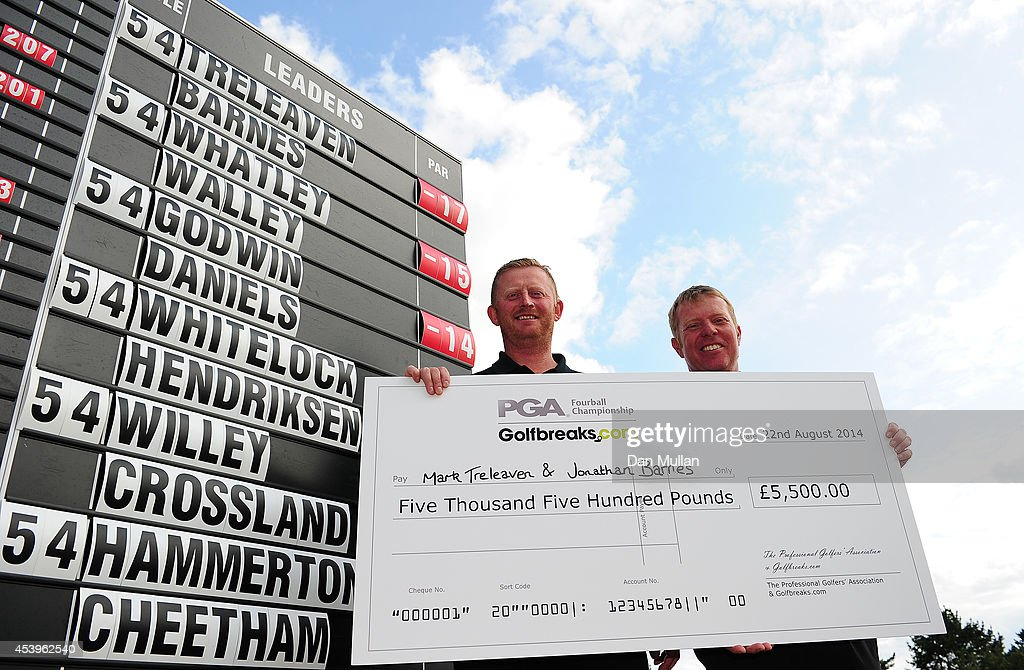 Jonathan Barnes (R) of Lee-on-The-Solent Golf Club and Mark Treleaven of Hayling Golf Club celebrate with their cheque after being crowned champions during day three of the Golfbreaks.com PGA Fourball Championship at St. Mellion International Resort on August 22, 2014 in Saltash, England.