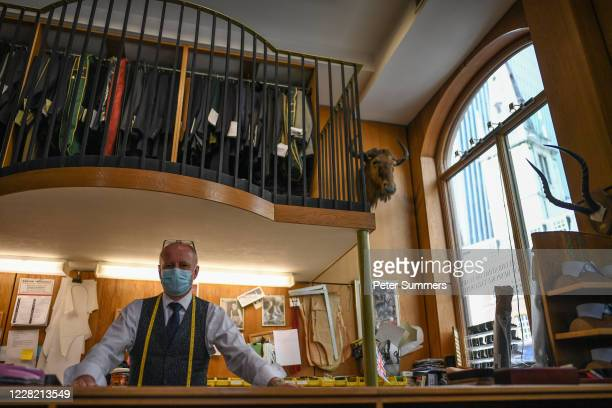 Jonathan Becker owner of Couch and Hoskin Bespoke Tailors poses for a portrait at his shop in the City of London on August 26 2020 in London England...