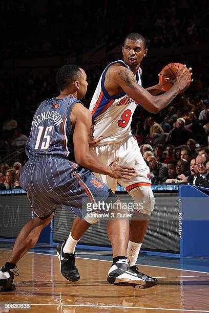 Jonathan Bender of the New York Knicks handles the ball against Gerald Henderson of the Charlotte Bobcats during the game on December 20 2009 at...