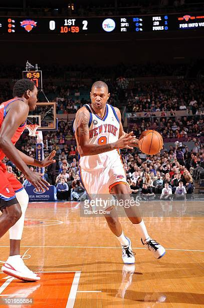 Jonathan Bender of the New York Knicks makes a move to the basket against Samuel Dalembert of the Philadelphia 76ers during the game at Madison...