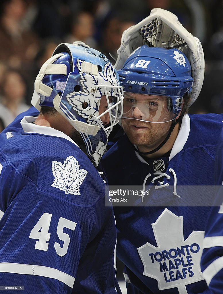 Jonathan Bernier #45 and Phil Kessel #81 f the Toronto Maple Leafs celebrate the teams win over the Anaheim Ducks during NHL game action October 22, 2013 at Air Canada Centre in Toronto, Ontario, Canada.