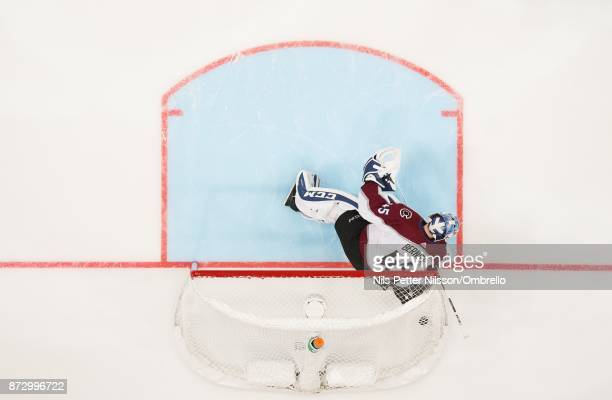 Jonathan Bernier goaltender of Colorado Avalanche lets the puck in to the net to make it 10 on a shot from Mike Hoffman of Ottawa Senators during the...