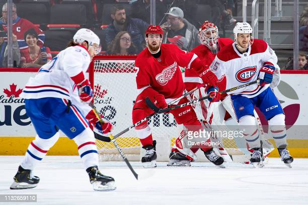 Jonathan Bernier of the Detroit Red Wings follows the play as teammate Filip Hronek defends against Andrew Shaw of the Montreal Canadiens during an...