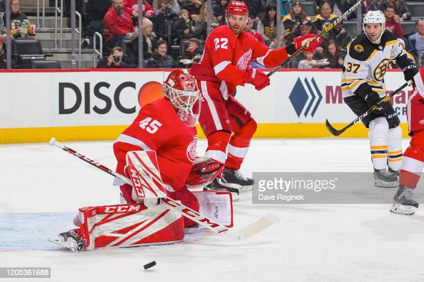 Jonathan Bernier of the Detroit Red Wings makes a leg pad save against the Boston Bruins during an NHL game at Little Caesars Arena on February 9,...