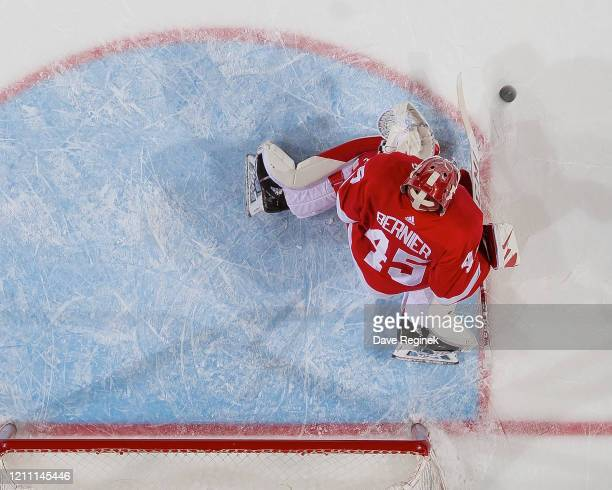 Jonathan Bernier of the Detroit Red Wings makes a save against the Chicago Blackhawks during an NHL game at Little Caesars Arena on March 6 2020 in...