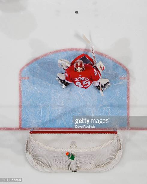 Jonathan Bernier of the Detroit Red Wings makes a save against the Chicago Blackhawks during an NHL game at Little Caesars Arena on March 6, 2020 in...