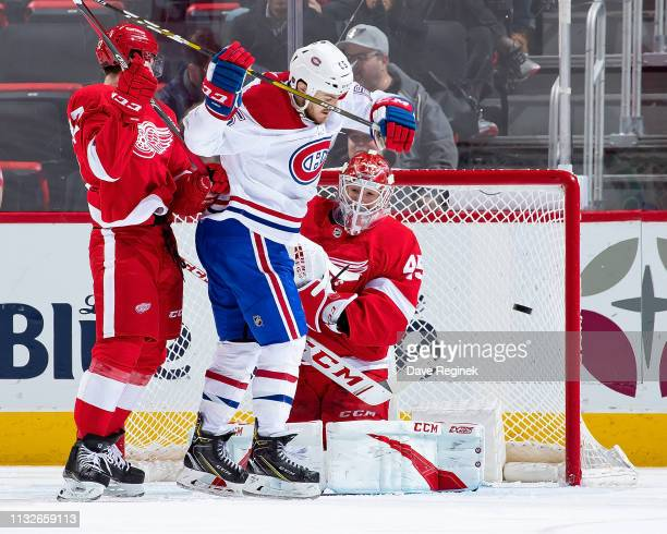 Jonathan Bernier of the Detroit Red Wings makes a shoulder save as teammate Filip Hronek defends against Andrew Shaw of the Montreal Canadiens during...