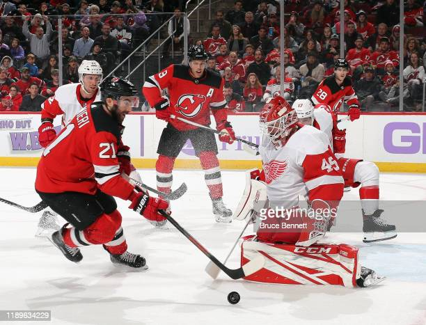 Jonathan Bernier of the Detroit Red Wings makes the second period save on Kyle Palmieri of the New Jersey Devils at the Prudential Center on November...