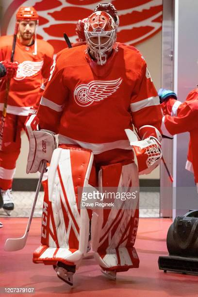 Jonathan Bernier of the Detroit Red Wings walks out to the rink for warm ups prior to an NHL game against the Montreal Canadiens at Little Caesars...