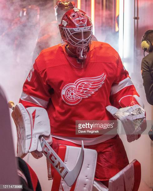 Jonathan Bernier of the Detroit Red Wings walks out to the rink for the start of the first period during an NHL game against the Tampa Bay Lightning...