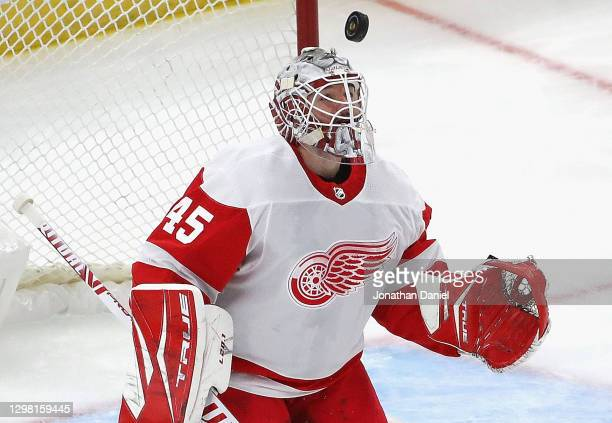 Jonathan Bernier of the Detroit Red Wings watches as the puck sails over his head against the Chicago Blackhawks at the United Center on January 24,...