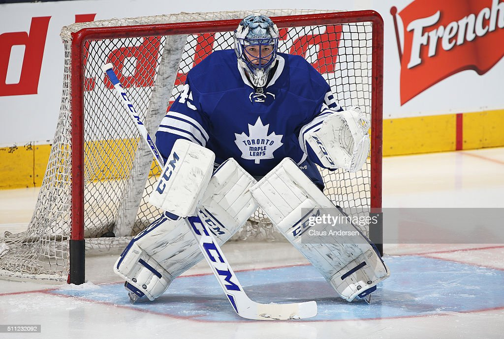 Jonathan Bernier #45 of the Toronto Maple Leafs faces a shot in the warm-up prior to play against the New York Rangers in an NHL game at the Air Canada Centre on February 18, 2016 in Toronto, Ontario, Canada.