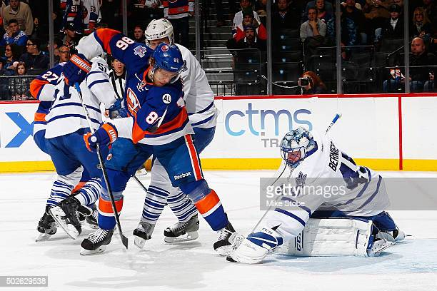Jonathan Bernier of the Toronto Maple Leafs makes a save on Nikolay Kulemin of the New York Islanders during the game at the Barclays Center on...