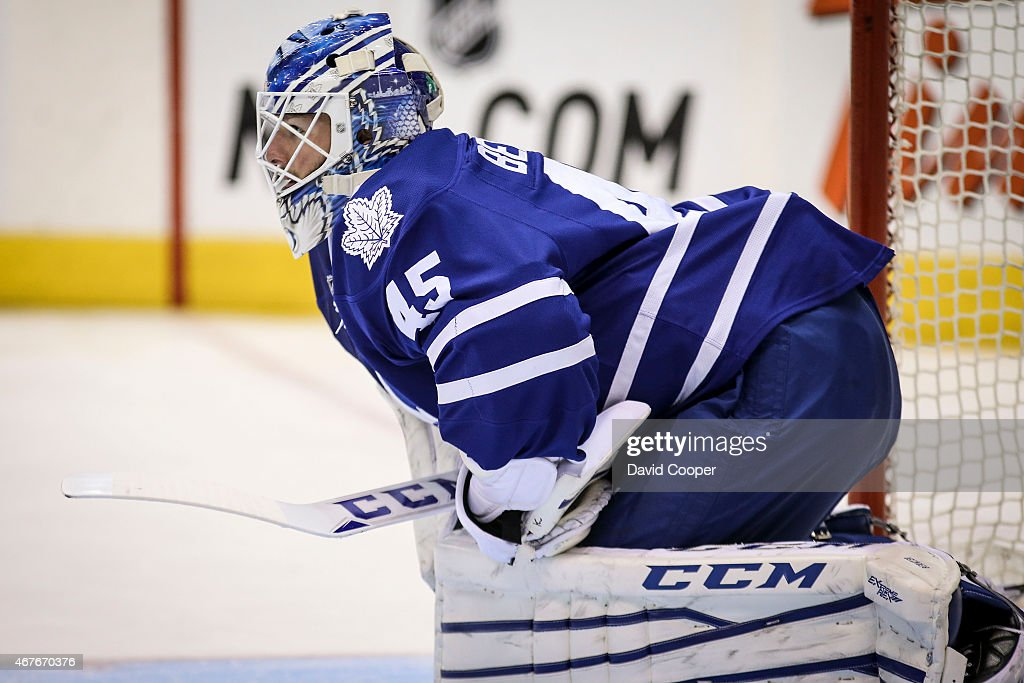 Jonathan Bernier (45) of the Toronto Maple Leafs takes a breather in the blue paint shortly before being replaced by James Reimer (34) : News Photo