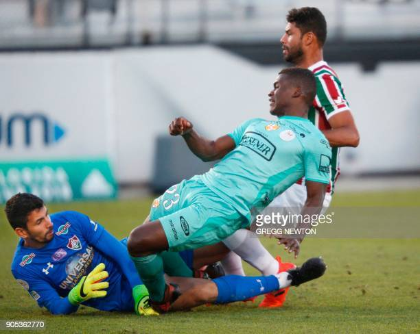 Jonathan Betancurt from Barcelona SC of Ecuador collides with goal keeper Marcos Felipe of Brazilian club Fluminense after scoring the seond of his...
