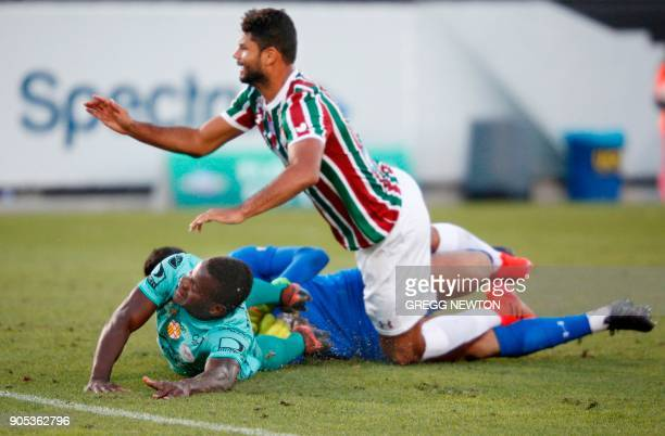 Jonathan Betancurt from Barcelona SC of Ecuador collides with goal keeper Marcos Felipe and defender Welington Gum Pereira of Brazilian club...