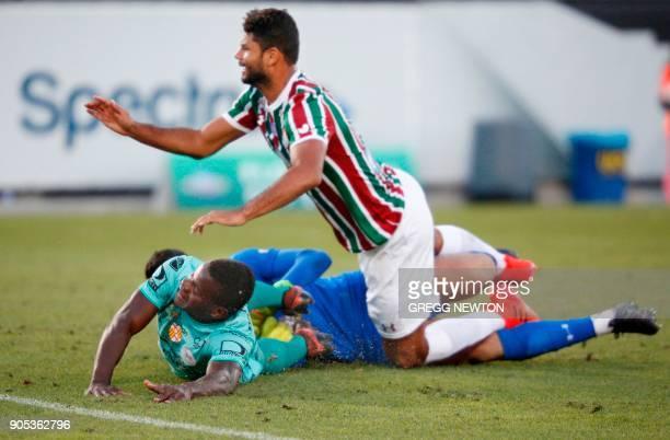 Jonathan Betancurt from Barcelona SC of Ecuador collides with goal keeper Marcos Felipe and defender Welington Gum Pereira of Brazilian club...