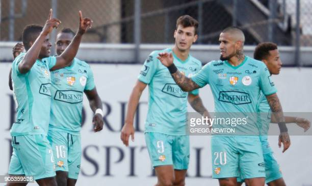 Jonathan Betancurt from Barcelona SC of Ecuador is congratulated by teammates after scoring the first of his two goals against Brazilian club...