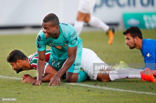 Jonathan Betancurt from Barcelona SC of Ecuador smiles after beating goal keeper Marcos Felipe and defender Welington Gum Pereira of Brazilian club...