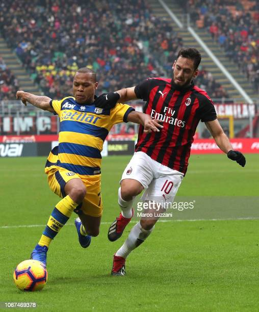 Jonathan Biabiany of AC Milan competes for the ball with Hakan Calhanoglu of Parma Calcio during the Serie A match between AC Milan and Parma Calcio...