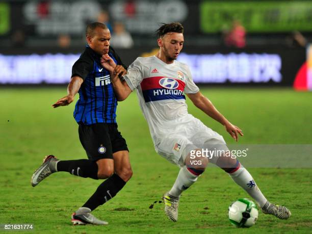 Jonathan Biabiany of FC Internazionale and Amine Gouiri of Lyon compete for the ball during the 2017 International Champions Cup match between FC...