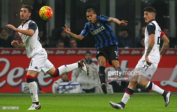 Jonathan Biabiany of FC Internazionale Milano is challenged by Nicola Murru and Alessandro Deiola of Cagliari Calcio during the TIM Cup match between...