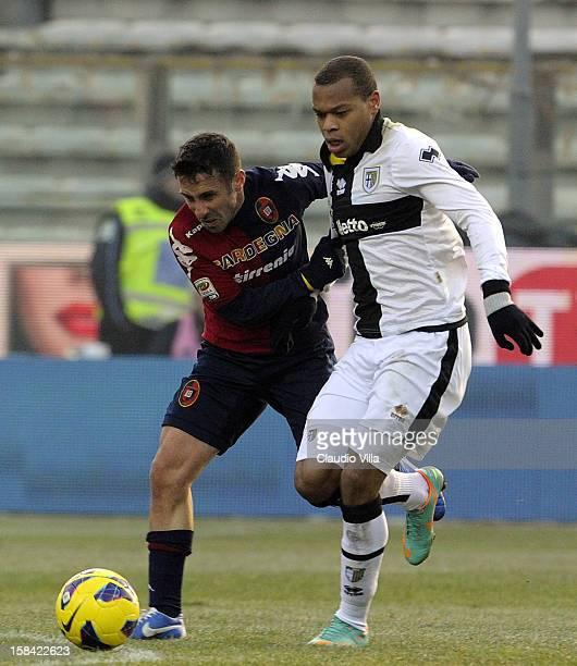 Jonathan Biabiany of Parma FC and Andrea Cossu of Cagliari Calcio compete for the ball during the Serie A match between Parma FC and Cagliari Calcio...