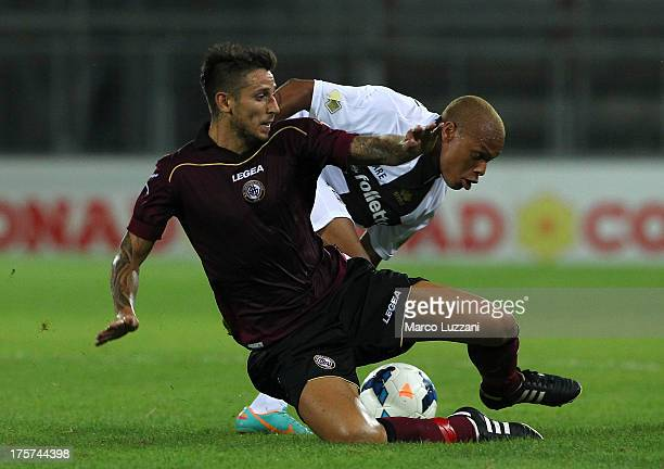 Jonathan Biabiany of Parma FC competes for the ball with Leandro Greco of AS Livorno during the preseason tournament between Parma FC AS Livorno and...