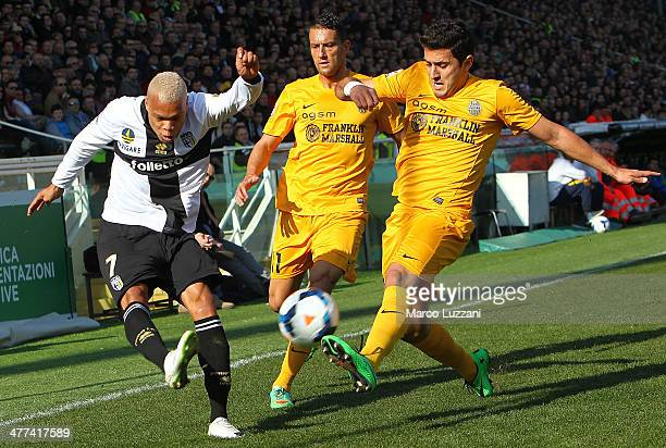 Jonathan Biabiany of Parma FC competes for the ball with Marco Antonio de Mattos Filho and Bosko Jankovic of Hellas Verona FC during the Serie A...