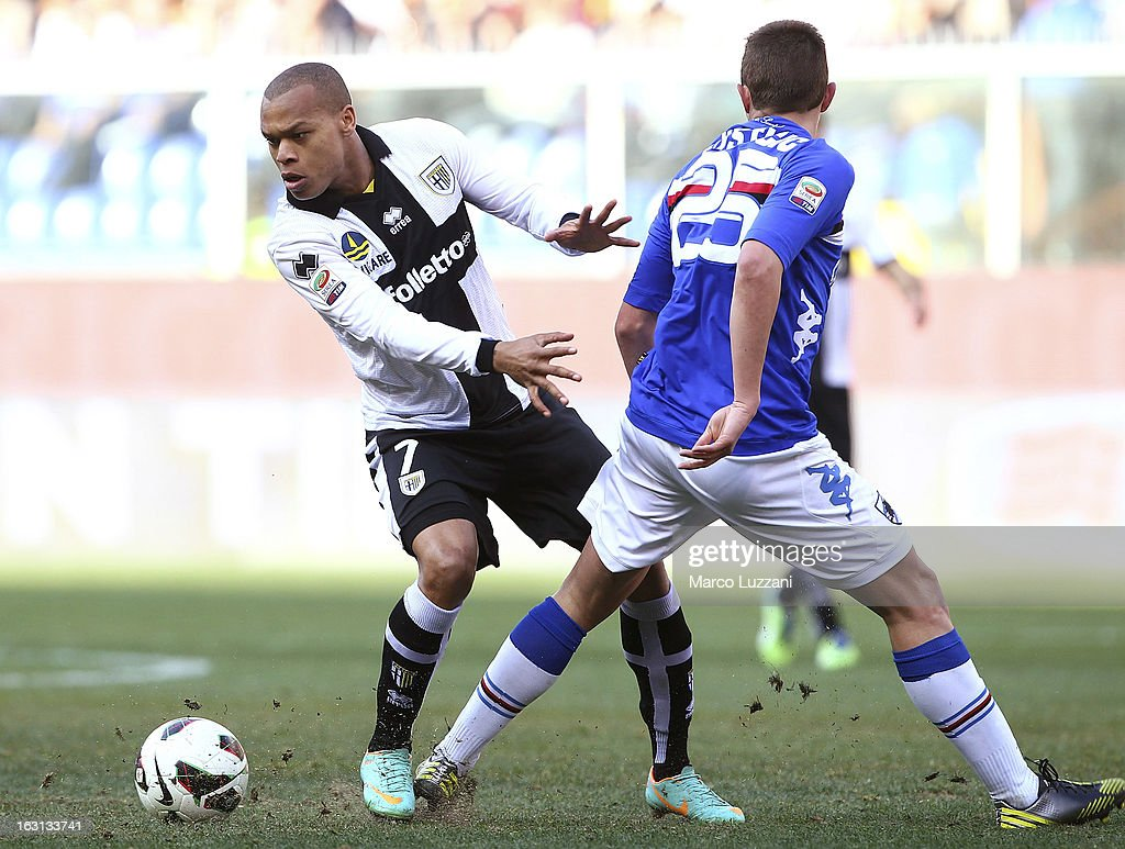 Jonathan Biabiany (L) of Parma FC competes for the ball with Nenad Krsticic of UC Sampdoria during the Serie A match between UC Sampdoria and Parma FC at Stadio Luigi Ferraris on March 3, 2013 in Genoa, Italy.