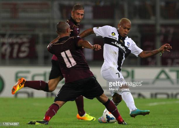 Jonathan Biabiany of Parma FC competes for the ball with Pasquale Schiattarezza of AS Livorno during the preseason tournament between Parma FC AS...
