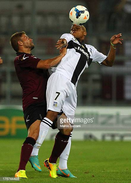 Jonathan Biabiany of Parma FC competes for the ball with Teodorico Dionisi of AS Livorno during the preseason tournament between Parma FC AS Livorno...