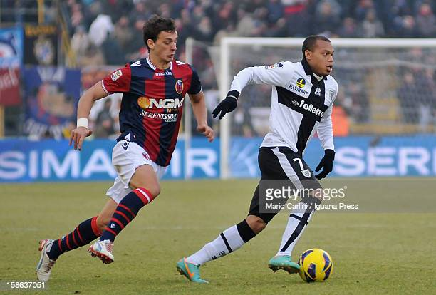 Jonathan Biabiany of Parma FC competes the ball with Manolo Gabbiadini of Bologna FC during the Serie A match between Bologna FC and Parma FC at...