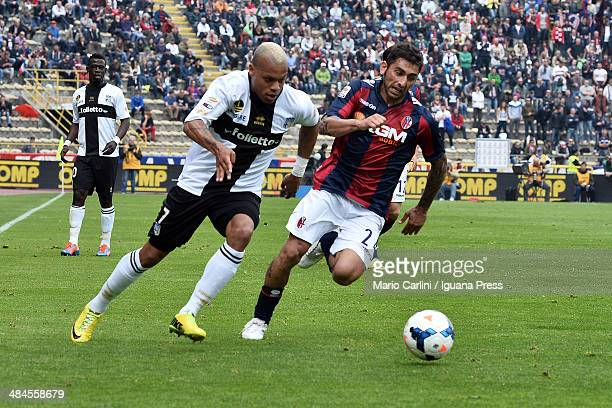Jonathan Biabiany of Parma FC competes the ball with Michele Pazienza of Bologna FC during the Serie A match between Bologna FC and Parma FC at...