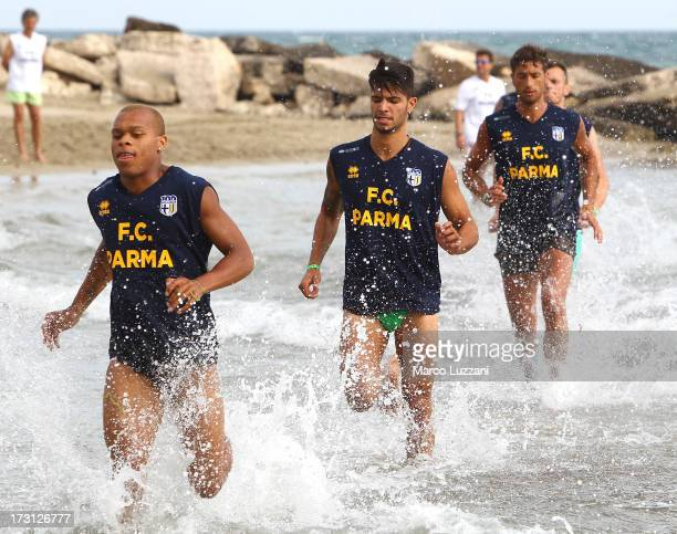 Jonathan Biabiany Pedro Mendes and Antonio Mirante of Parma FC train on the shoreline during a Parma FC preseason training session at Rosa Marina...