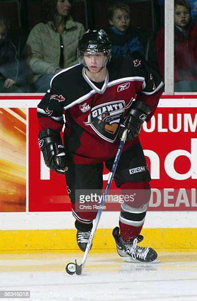 Jonathan Blum of the Vancouver Giants controls the puck in the corner against the Prince George Cougars during their WHL game on October 14 2005 at...