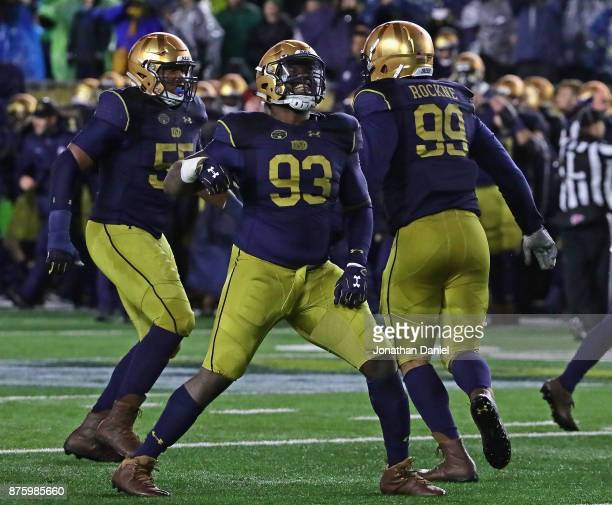 Jonathan Bonner, Jay Hayes and Jerry Tillery of the Notre Dame Fighting Irish celebrate a defensive stop on 4th down against the Navy Midshipmen at...
