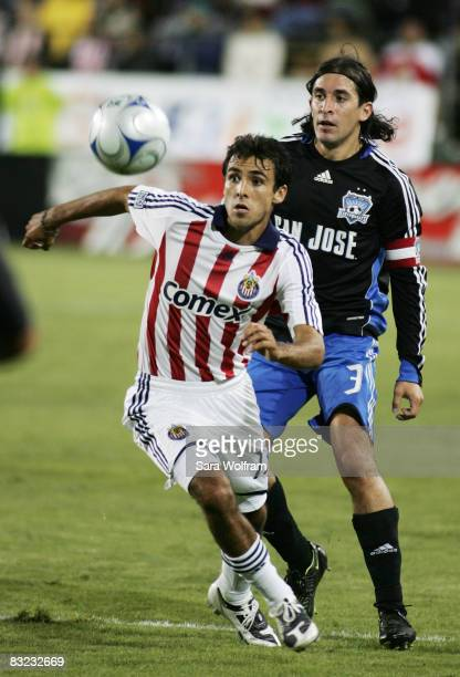 Jonathan Bornstein of Chivas USA fights for the ball against Nick Garcia of the San Jose Earthquakes during the MLS game at Buck Shaw Stadium on...