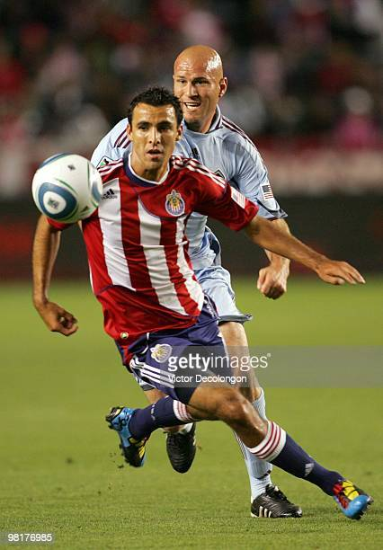 Jonathan Bornstein of Chivas USA turns to the ball in front of Conor Casey of the Colorado Rapids during their MLS match at the Home Depot Center on...